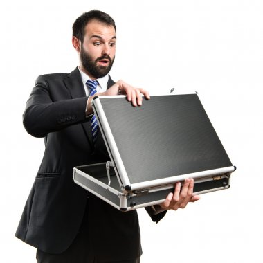 Young businessman open his briefcase over white background