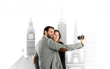 Man photographing with his girlfriend in a trip