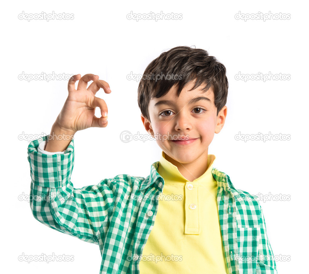 2ef9d6478f Boy making a OK sign over white background — Stock Photo ...