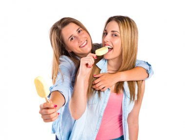 Friends eating ice cream over white background