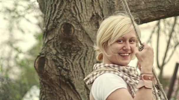Blonde adult women swaying in nature and enjoying