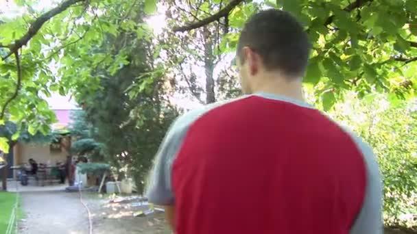 Man carrying a little boy