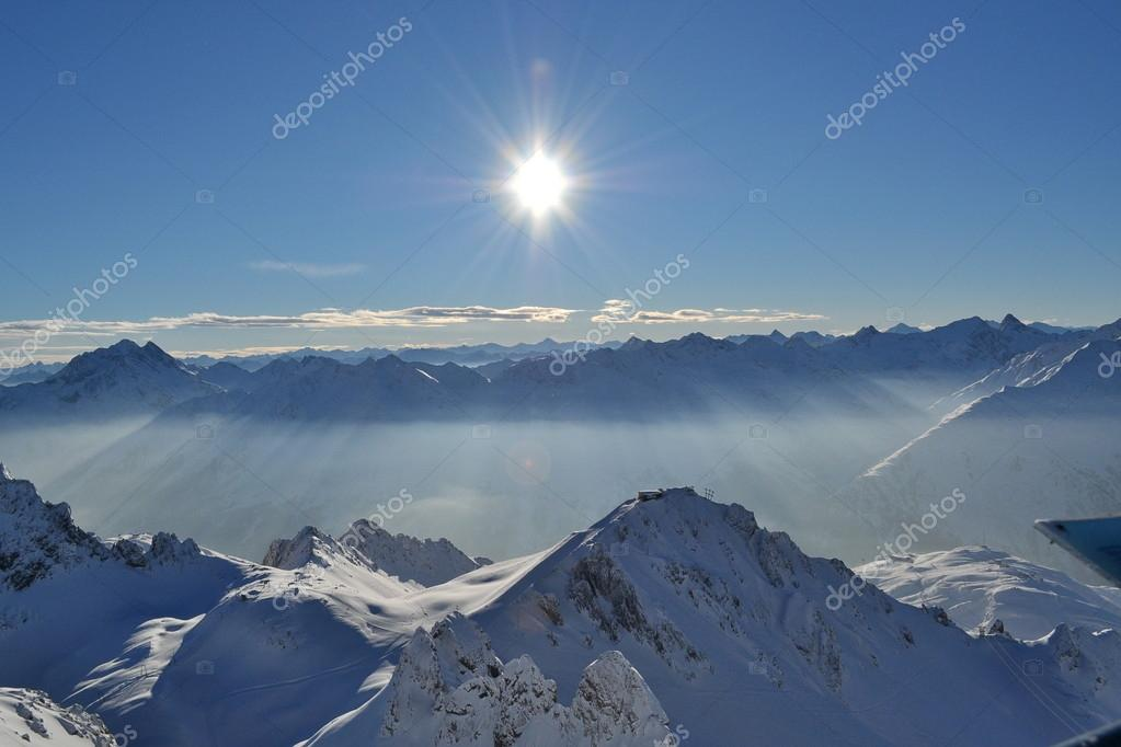 Rays of the sun through the morning haze in Alps