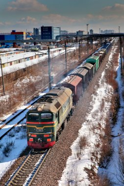 Freight train moving by rail, Russia, winter, top view.