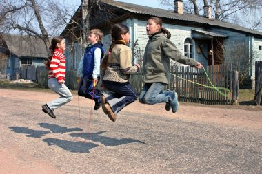 Russian, rural schoolchildren during recess, jumping rope