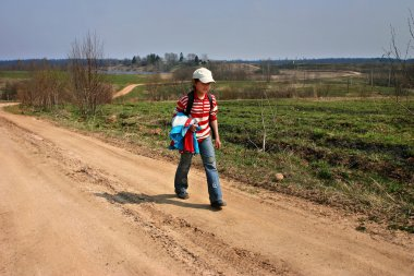 Countryside Russia, village girl 11 years old, returned from school.