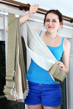 Girl holding fabric for vertical blind slats