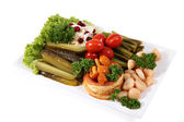assorted pickled vegetables on the plate, isolated over  white