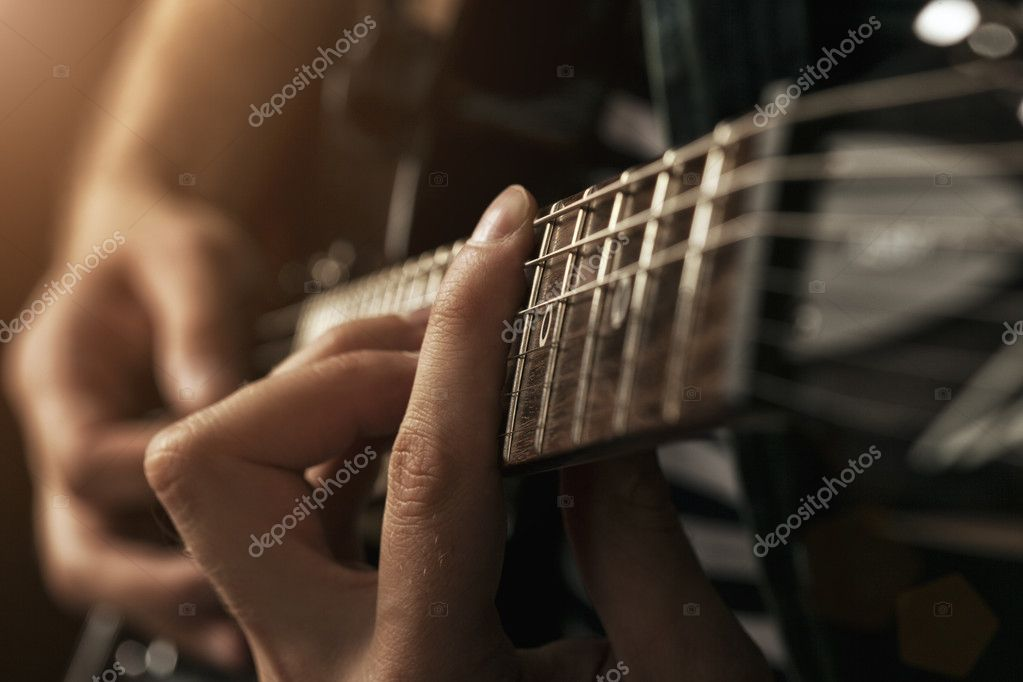 guitarist plays