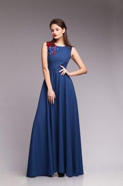 Girl in blue dress. Portrait. Studio. Fashion