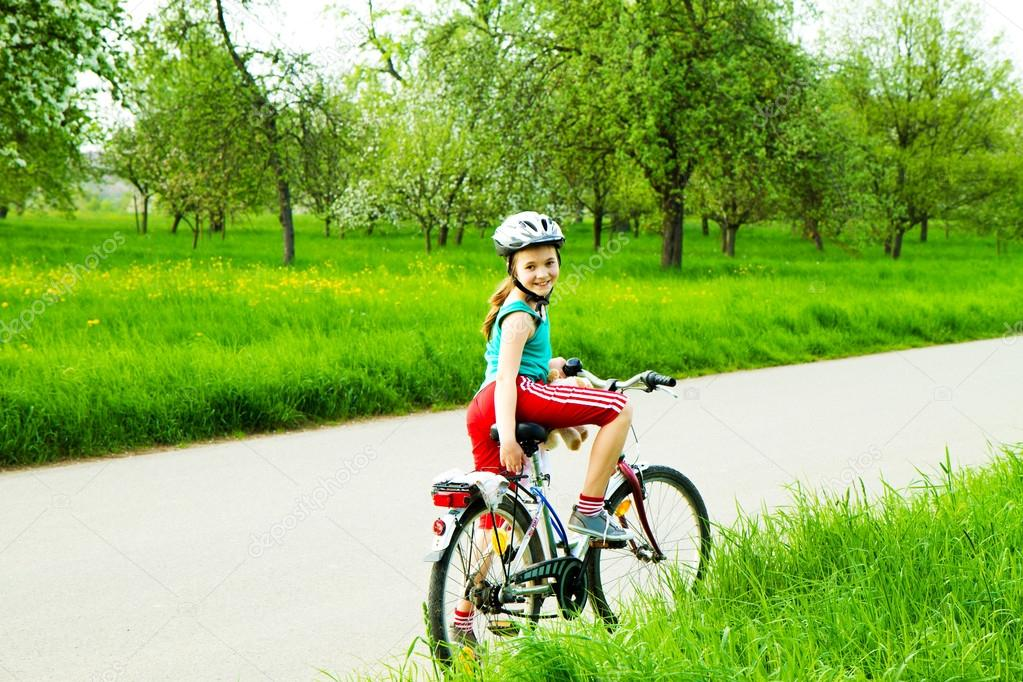 Happy girl on bicycle