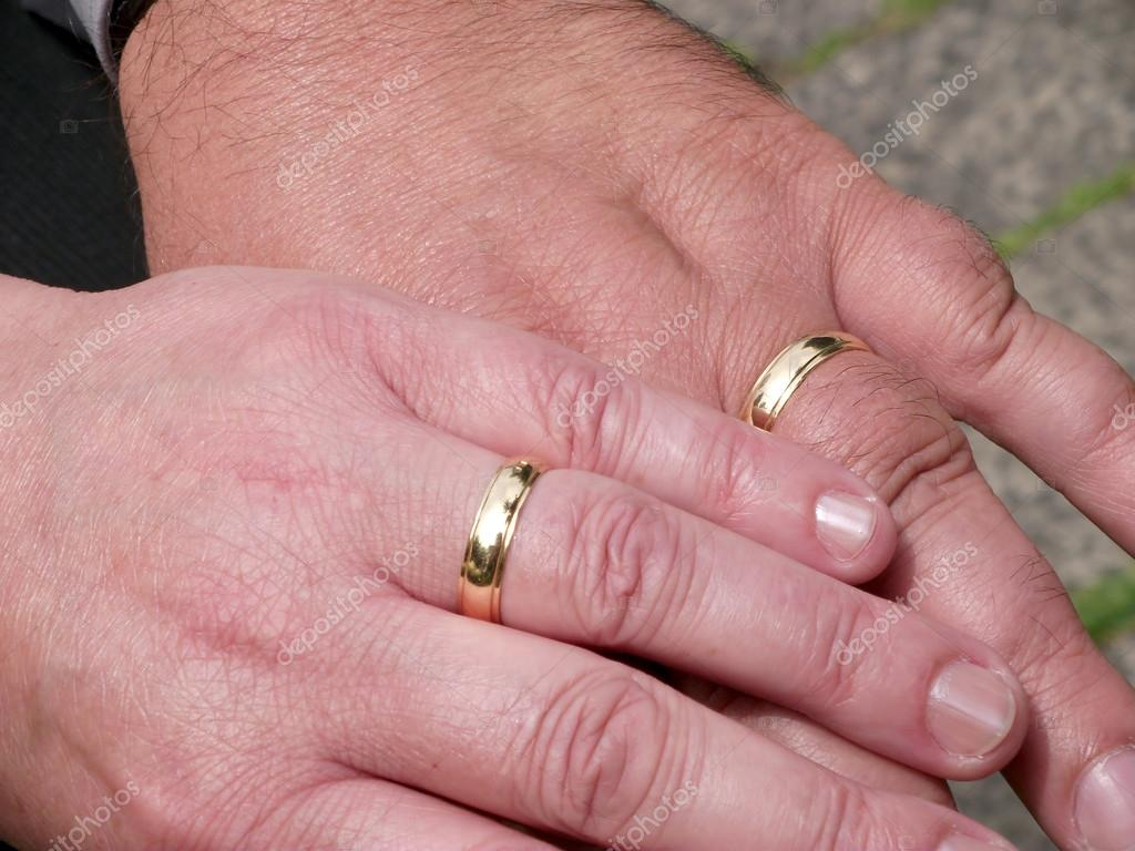Two Hands with wedding rings — Stock Photo © Medieval #25242701