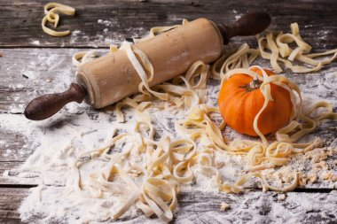 Raw homemade pasta with pumpkin