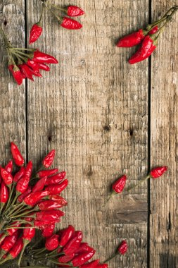 Wooden background with red hot chili peppers