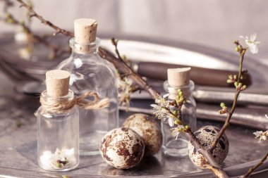 Easter interior with vials and quail eggs