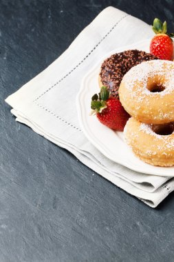 Donuts with fresh strawberries