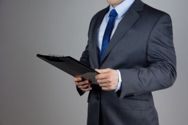 Business man holding folder with documents