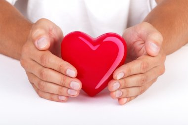 Hands protecting heart