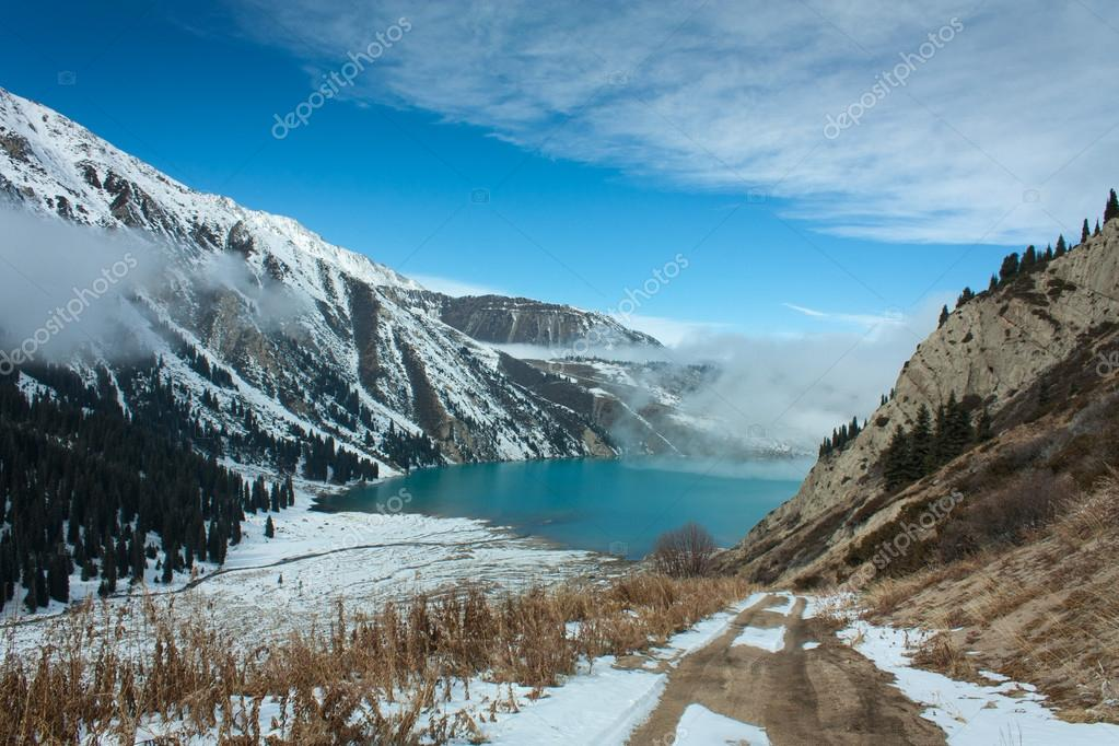 Mountain lake with snow