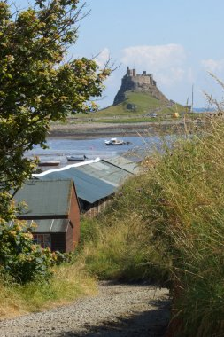 Low tide at Holy Island with Lindisfarne Castle in the background