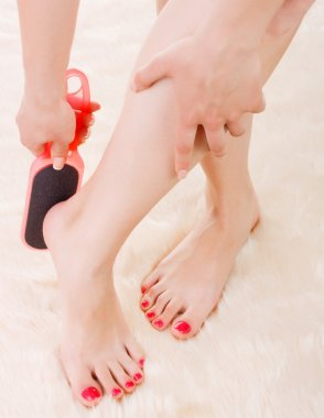 girl doing pedicure