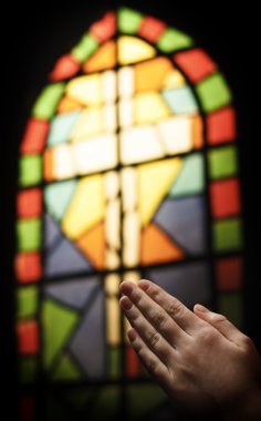 Praying Hands And Stained Glass Church Window