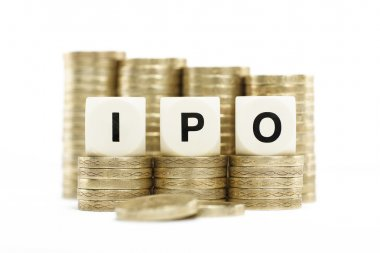 IPO (Initial Public Offering) on coin stacks with white backgrou