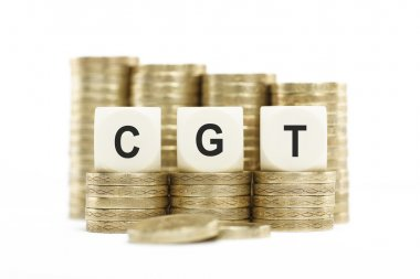 CGT (Capital Gains Tax) on Stacked Coins Isolated White Backgrou