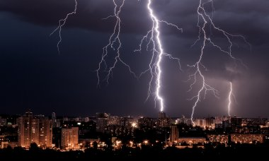 Lightning storm over city at night