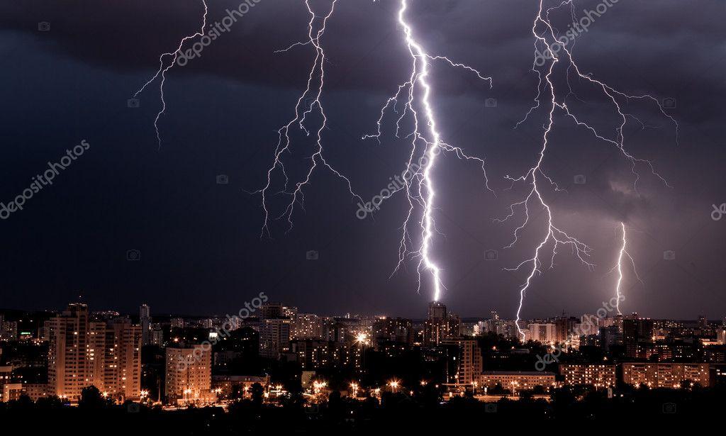 Lightning storm over city at night