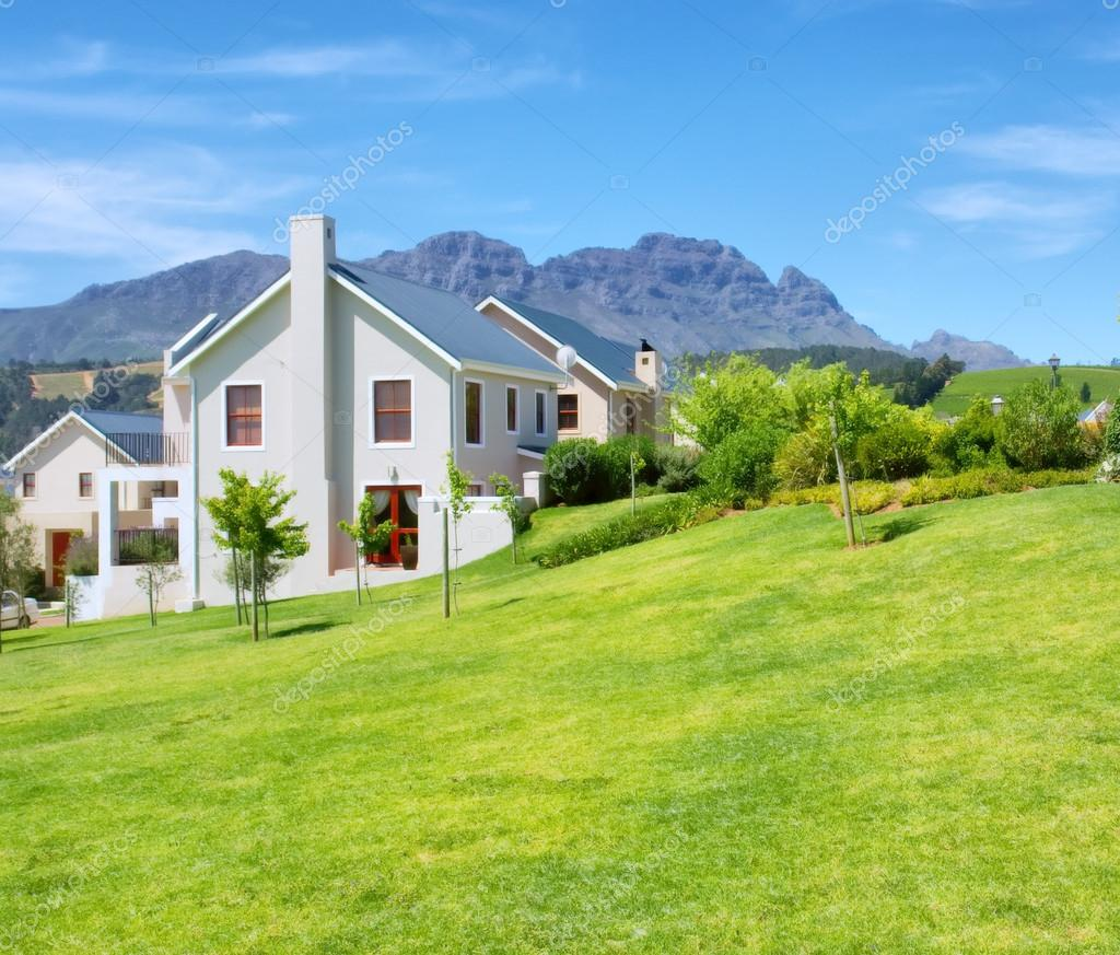 Cape-style house against blue misty mountains