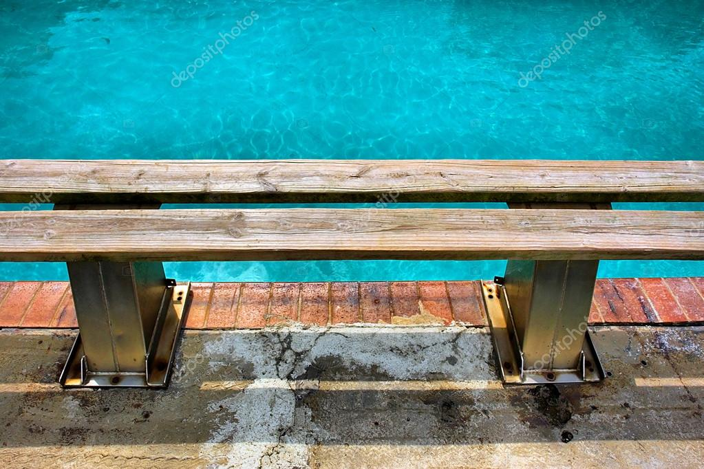 Wondrous Wooden Bench Next To Pool Stock Photo C Photosky 21644797 Beatyapartments Chair Design Images Beatyapartmentscom
