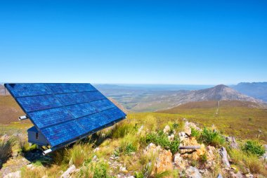 Blue solar cells against awesome mountain landscape