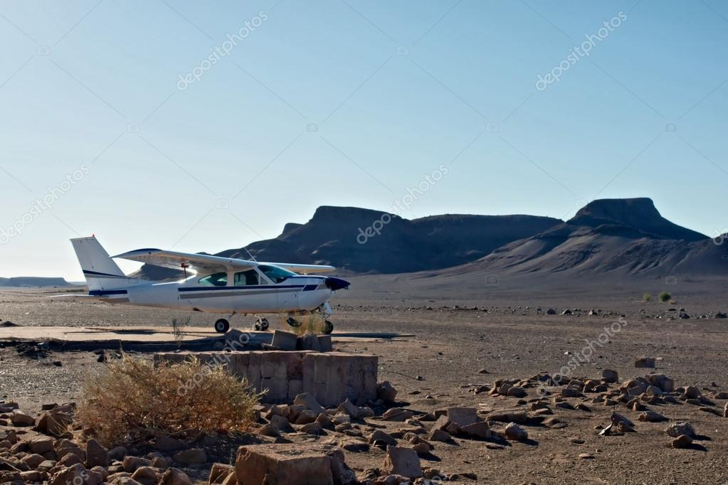 Small private airplane in desert