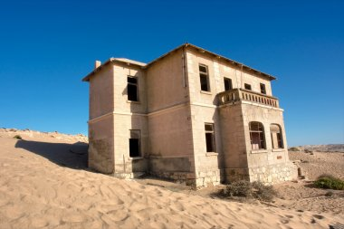 Abandoned house in sand