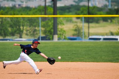 baseball player reach out to catch ball