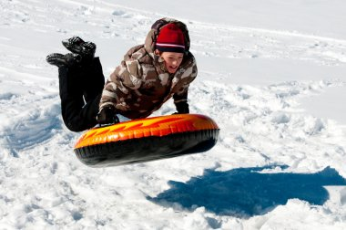 Boy tubing in the snow