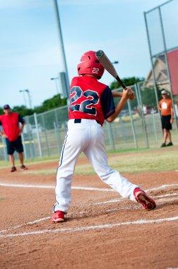 Young baseball player swinging the bat
