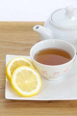 Cup of tea with lemon slice