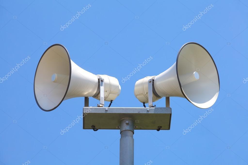 Loud speaker on blue sky