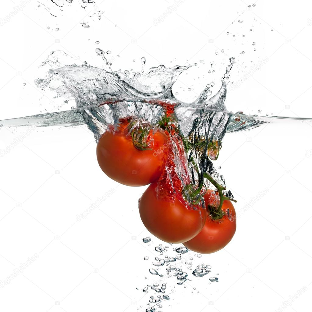Fresh Red Tomatoes Splash in Water Isolated on White Background