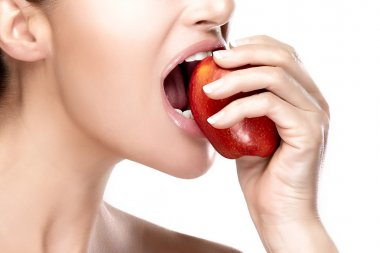 Beautiful Healthy Mouth Biting a Big Red Apple
