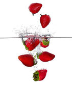Fresh Strawberries Splash in Water Isolated on White Background