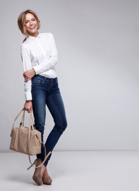 Beautiful happy business woman holding a bag