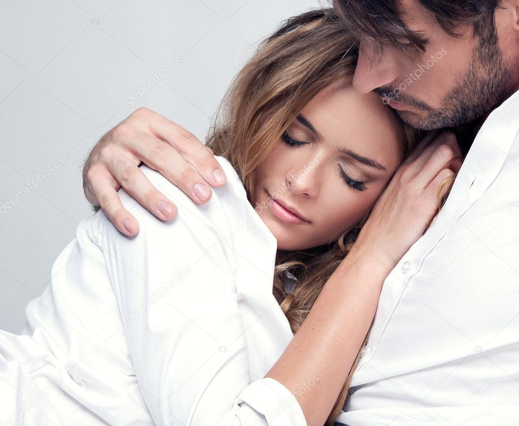Portrait of romantic couple touching and kissing each for Love pictures in bed