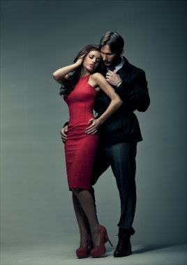 Fashion style photo of sexy couple touching each other
