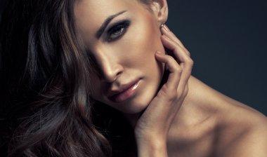 Beautiful brunette woman in studio stock vector