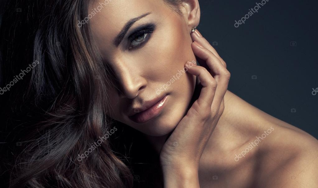Portrait of perfect Makeup. Beautiful sexy woman with long Hair