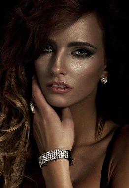 Fashion portrait of young beautiful woman with diamond jewelry