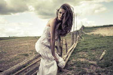 Young woman in white dress outdoor